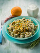 pasta with artichoke cream and orange peel, selective focus