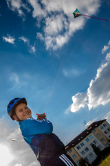 happy boy with kite from the sun