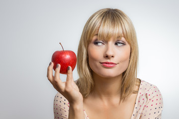 Girl looks at apple