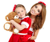 Woman and little girl wearing santa claus costume