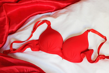 Red bra on bed