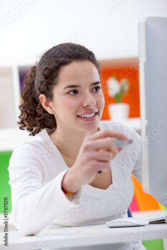 girl inserting usb flash memory into computer