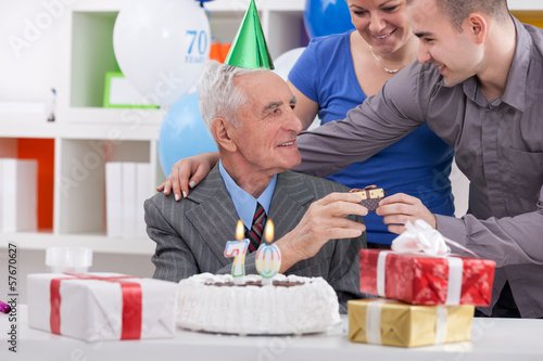 senior man on birthday with his family