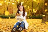 Happy woman enjoying in autumn