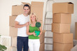 Couple in room full of cardboard boxes