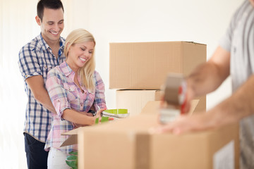 Smiling couple moving house