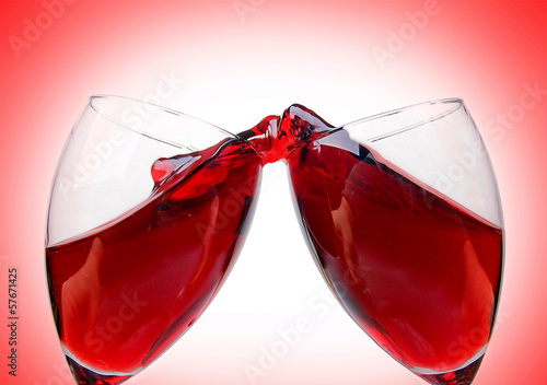 Clinking wine glasses