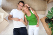 couple lying on floor of new flat