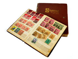 Old stamp album book on white