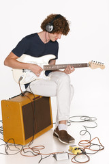 Full length male musician with his electric guitar