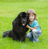 girl hugging Newfoundland dog