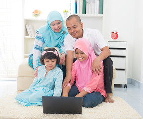 malay indonesian family surfing internet at home.