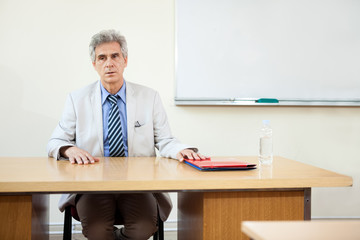 professor sitting at desk