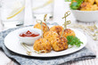 chicken meatballs in breading with tomato sauce