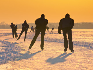 Skaters during sunset