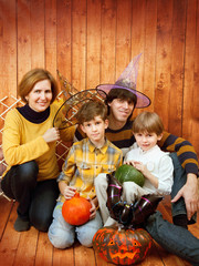 The family sit with Halloween's carved pumpkin