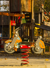 Sprung motorcycle at the playground