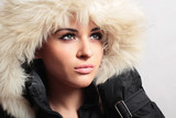 Beautiful woman in hood.white fur.winter style.fashion girl