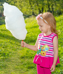 Girl holding cotton candy