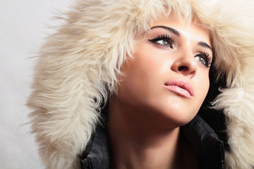 beautiful woman with fur.white fur hood.winter style.fashion