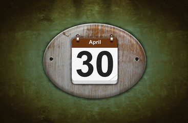 Old wooden calendar with April 30.