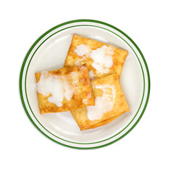 Three toaster pastries on a plate