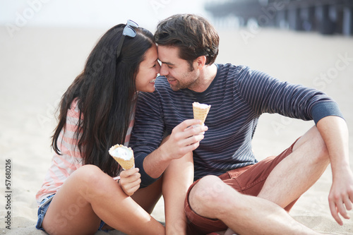 happy couple with ice cream near santa monica pier