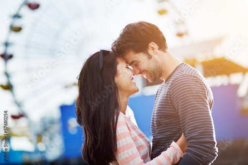 romantic couple embracing at santa monica