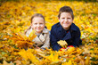 Little kids outdoors at autumn day