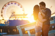 romantic couple kissing in front of santa monica - 57680621