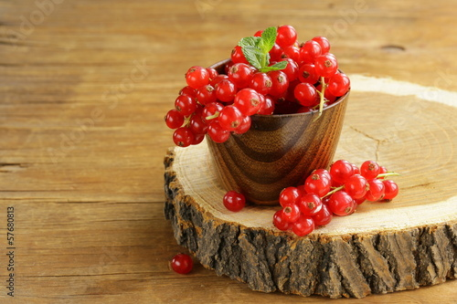 Organic sweet ripe red currant with green leaves