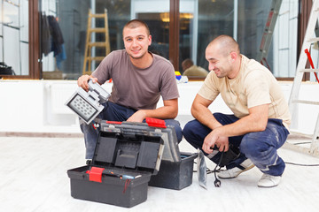 Joyful Handy Men and Their Tool Boxes