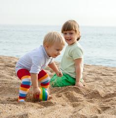 girls play on the beach