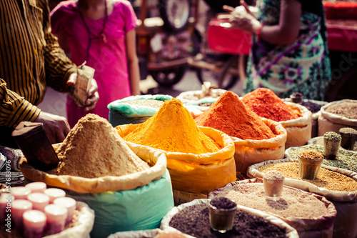 Poster Traditional spices and dry fruits in local bazaar in India.