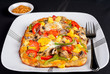 Hot fresh vegetarian flatbread pizza with eggs.