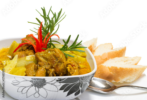 Hot and delicious chicken curry with breads isolated