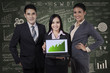 Business people holding growth graph