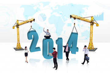 Business people building the new year 2014