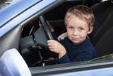 Boy driving a car