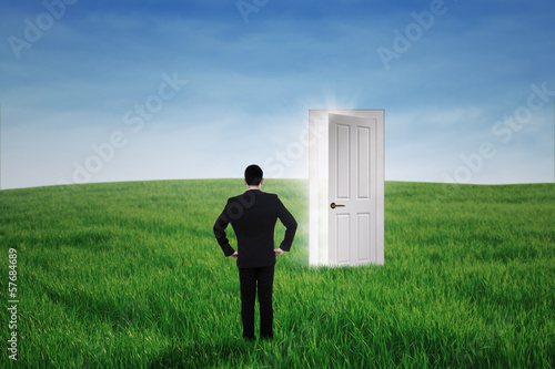 Businessman standing at an opportunity door