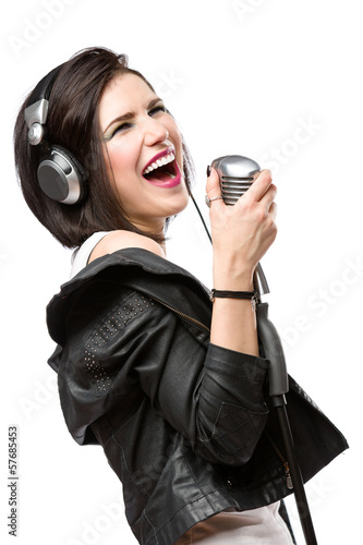 Half-length portrait of rock singer with headphones