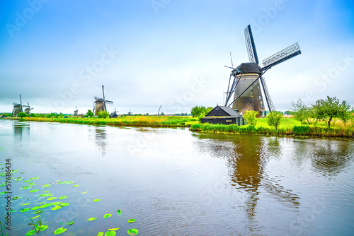 Windmills and canal in Kinderdijk, Holland or Netherlands. - 57686434
