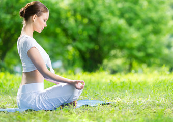 Profile of woman who sits in lotus position zen gesturing