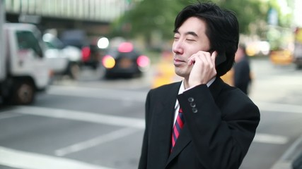 Asian businessman working in New York City cellphone