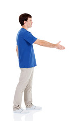 side view of casual young man handshake