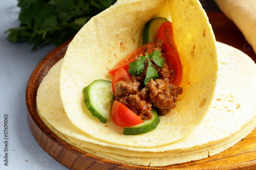 Fresh tortilla fajita wraps with beef and vegetables