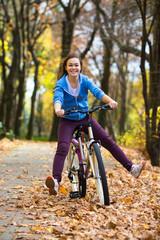 Girl biking in city park