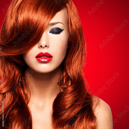 Portrait  of a  woman with long red hairs