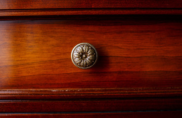 Antique brown cupboard in the room