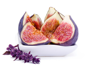 Some juicy, ripe slices of  fig and basil flower